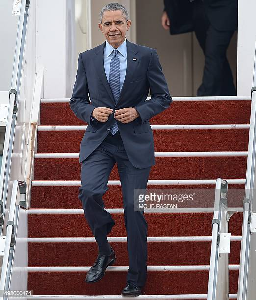 US President Barack Obama looks on as he disembarks from Air Force One at the Royal Malaysian Airforce base to attend the 27th Association of South...