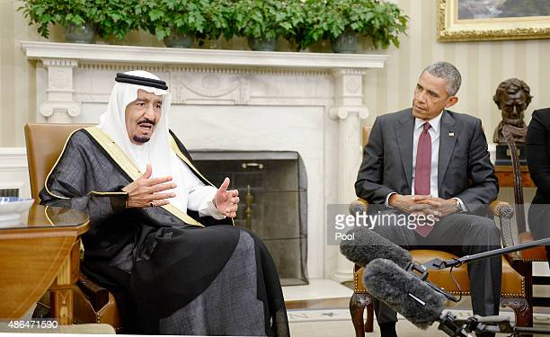 S President Barack Obama looks on as King Salman bin Abd alAziz of Saudi Arabia speaks during a bilateral meeting in the Oval Office of the White...