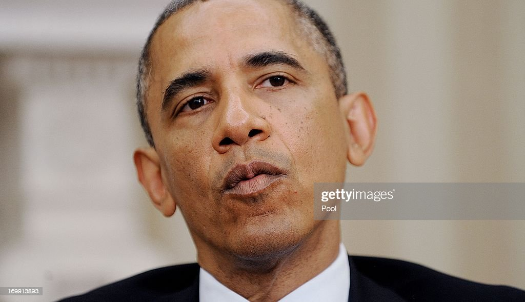 U.S. President <a gi-track='captionPersonalityLinkClicked' href=/galleries/search?phrase=Barack+Obama&family=editorial&specificpeople=203260 ng-click='$event.stopPropagation()'>Barack Obama</a> looks on during a meeting with Chilean President Sebastián Piñera in the Oval Office of the White House June 4 , 2013 in Washington, DC. Obama and Piñera spoke about an Asia-Pacific freetrade agreement and other regional issues.