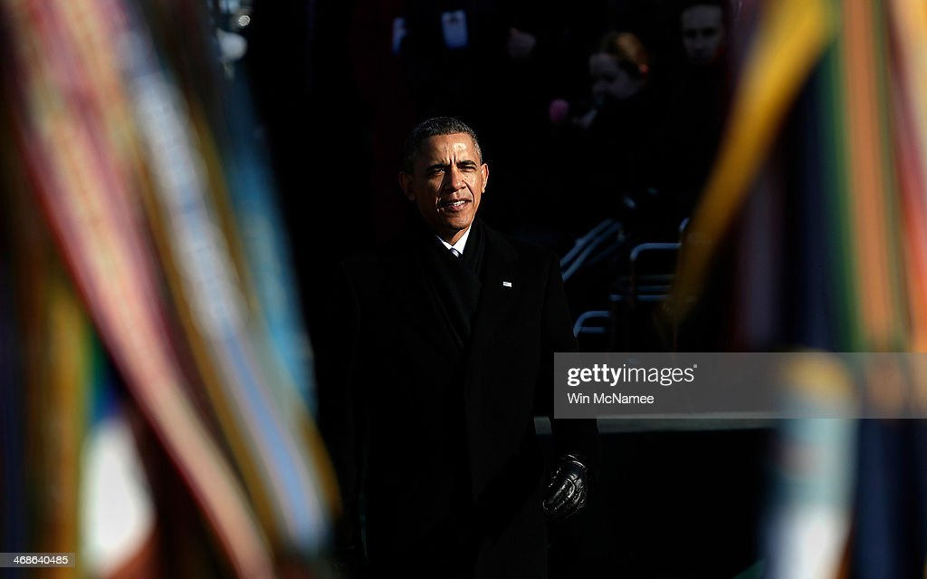 U.S. President <a gi-track='captionPersonalityLinkClicked' href=/galleries/search?phrase=Barack+Obama&family=editorial&specificpeople=203260 ng-click='$event.stopPropagation()'>Barack Obama</a> looks on during a review of military troops at a welcoming ceremony for French President Francois Hollande on the South Lawn at the White House on February 11, 2014 in Washington, DC. Hollande who arrived yesterday for a three day state visit, visited Thomas Jefferson's Monticello estate and will be the guest of honor for a state dinner tonight.