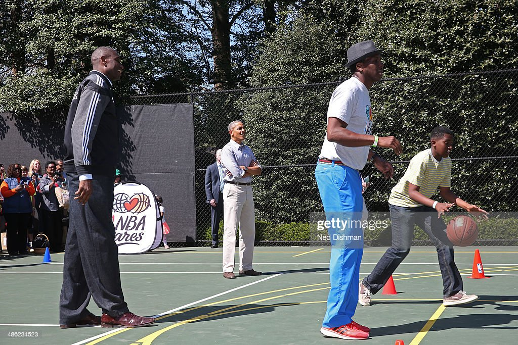 President Barack Obama looks on during an NBA Fit Clinic at the 2014 White House Easter Egg Roll on April 21, 2014 in Washington, DC.