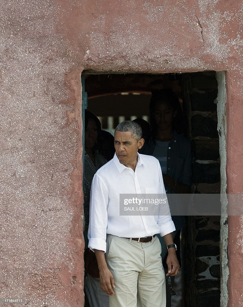 US President <a gi-track='captionPersonalityLinkClicked' href=/galleries/search?phrase=Barack+Obama&family=editorial&specificpeople=203260 ng-click='$event.stopPropagation()'>Barack Obama</a> looks out from the Door of No Return during a visit to the House of Slaves, or Maison des Esclaves, at Goree Island off the coast of Dakar on June 27, 2013. Obama and his family toured the museum at the site where African slaves were held before going through the door and being shipped off the continent as slaves.