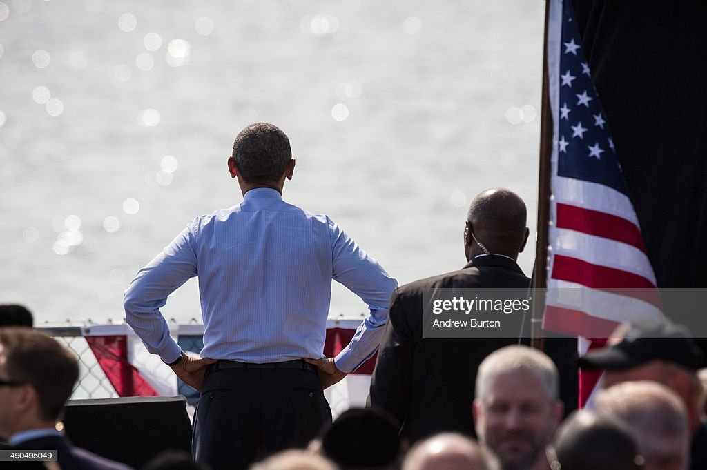 U.S. President Barack Obama (L) looks out over the Hudson river after delivering remarks on infrastructure in the United States at the Washington Irving Boat Club on May 14, 2014 in Tarrytown, New York. Tomorrow President Obama will attend the opening of the National September 11 Memorial and Museum.