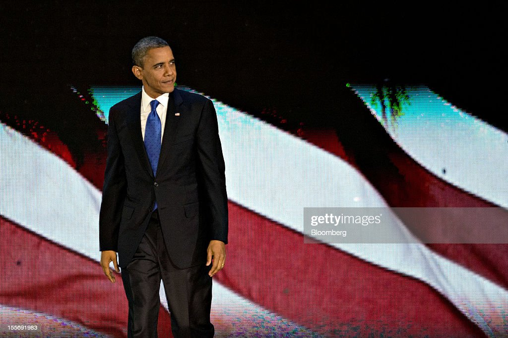 U.S. President Barack Obama looks over the crowd as he prepares to leave the stage after making an acceptance speech during an election night rally in Chicago, Illinois, U.S., in the early morning on Wednesday, Nov. 7, 2012. Obama, the post-partisan candidate of hope who became the first black U.S. president, won re-election today by overcoming four years of economic discontent with a mix of political populism and electoral math. Photographer: Daniel Acker/Bloomberg via Getty Images