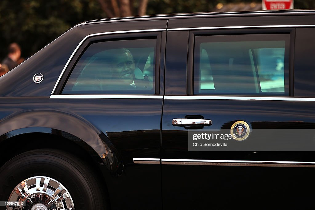 U.S. President Barack Obama looks through a limousine window as the presidential inaugural parade winds through the nation's capital January 21, 2013 in Washington, DC. Barack Obama was re-elected for a second term as President of the United States.