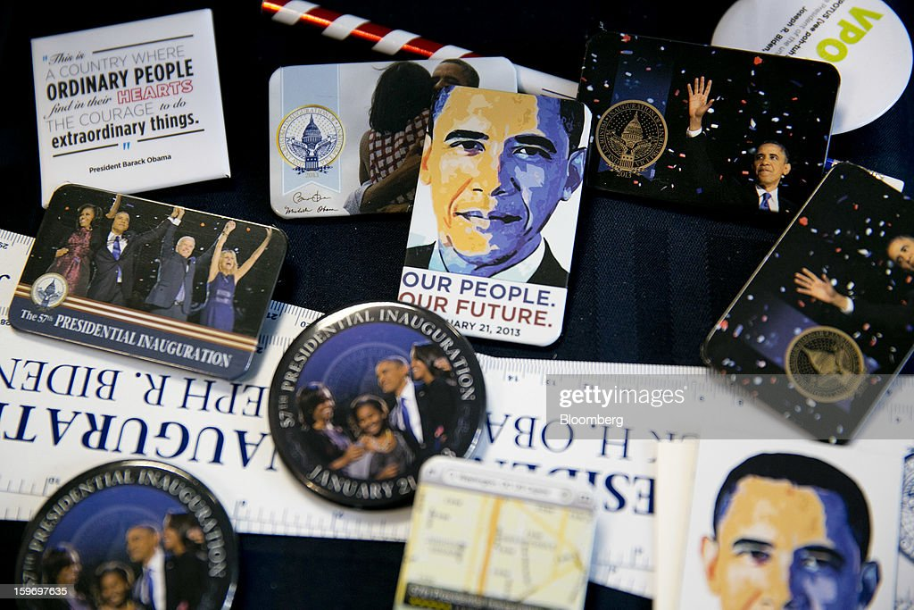 U.S. President Barack Obama magnets and buttons are arranged for a photograph at the Presidential Inaugural Committee store in Washington, D.C., U.S., on Friday, Jan. 18, 2013. President Obama's second inauguration next week will combine the star power of Beyonce, Kelly Clarkson and James Taylor with a lineup that reflects social values Obama will champion in his new term. Photographer: Andrew Harrer/Bloomberg via Getty Images