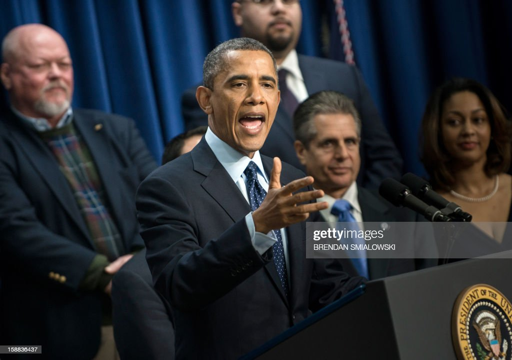 US President Barack Obama makes a statement about fiscal cliff negotiations from the White House December 31, 2012 in Washington, DC. Lawmakers in Washington continue to work on a last minute compromise to pass legislation to avoid a fiscal cliff of tax hikes and spending cuts in the United State's federal budget. AFP PHOTO/Brendan SMIALOWSKI