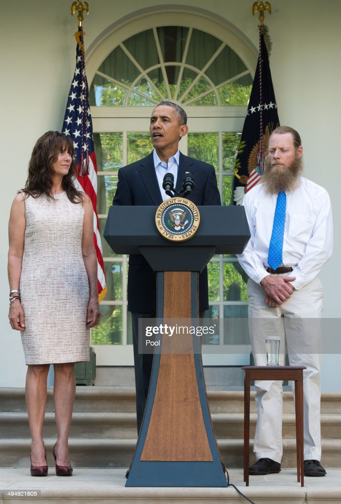 President <a gi-track='captionPersonalityLinkClicked' href=/galleries/search?phrase=Barack+Obama&family=editorial&specificpeople=203260 ng-click='$event.stopPropagation()'>Barack Obama</a> makes a statement about the release of Sgt. Bowe Bergdahl as his parents, Jani Bergdahl (L) and Bob Bergdahl (R) listen May 31, 2014 in the Rose Garden at the White House in Washington, DC. Sgt. Bowe Bergdahl was held captive by militants for almost five years during the war in Afghanistan.