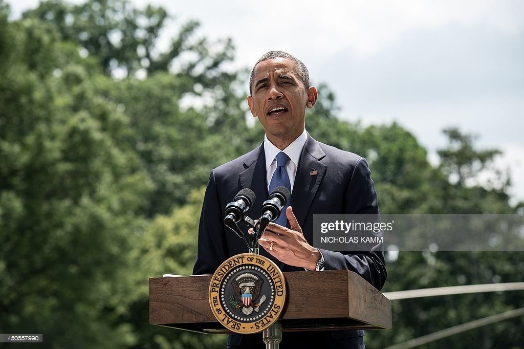 US President Barack Obama makes a statement on Iraq on the South Lawn of the White House in Washington on June 13, 2014. Obama said Friday that he is examining options short of sending ground troops to help Iraq counter a Sunni extremist offensive, but warned the country must heal its own divisions. 'We will not be sending US troops back into combat in Iraq, but I have asked my national security team to prepare a range of other options that could help support Iraqi security forces,' Obama said. AFP PHOTO/Nicholas KAMM