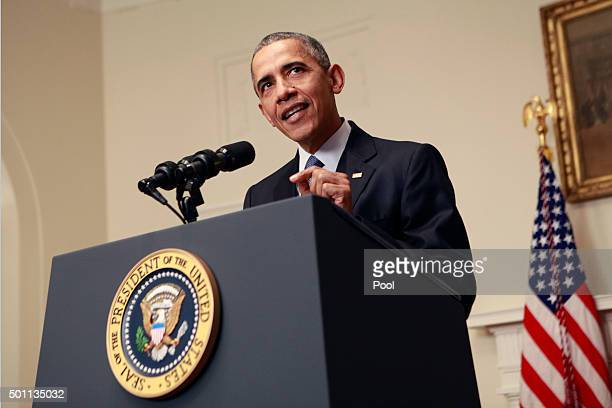 S President Barack Obama makes a statement on the climate agreement in the Cabinet Room of the White House on December 12 2015 in Washington DC Obama...