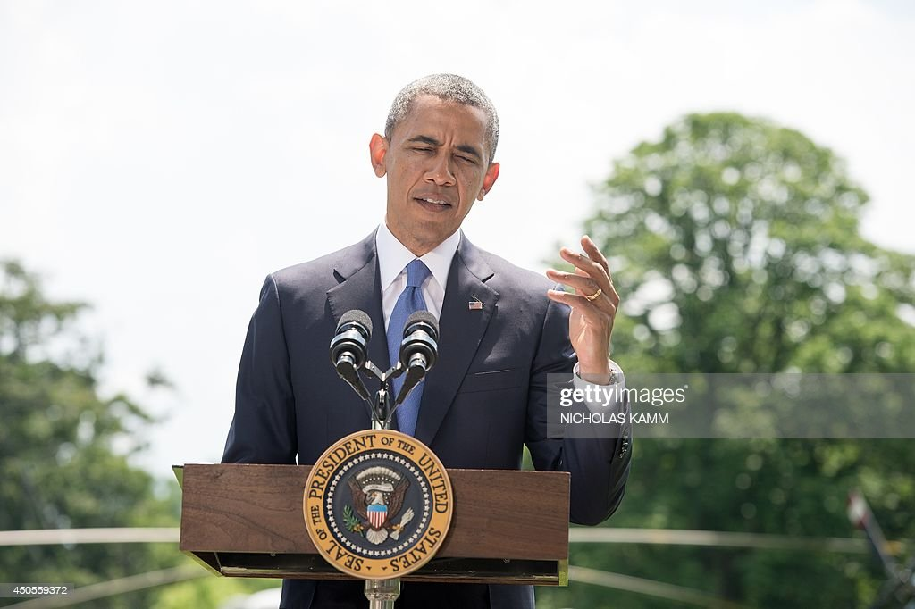 US President Barack Obama makes a statement on the situation in Iraq on the South Lawn of the White House in Washington on June 13, 2014. Obama said Friday that he is examining options short of sending ground troops to help Iraq counter a Sunni extremist offensive, but warned the country must heal its own divisions. 'We will not be sending US troops back into combat in Iraq, but I have asked my national security team to prepare a range of other options that could help support Iraqi security forces,' Obama said. AFP PHOTO/Nicholas KAMM