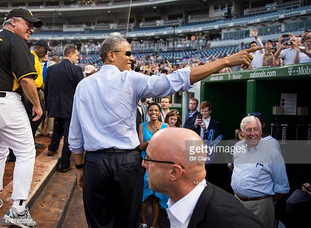 President Barack Obama makes a surprise visit to the Democrats' dugout during the 54th Annual Roll Call Congressional Baseball Game at Nationals Park...