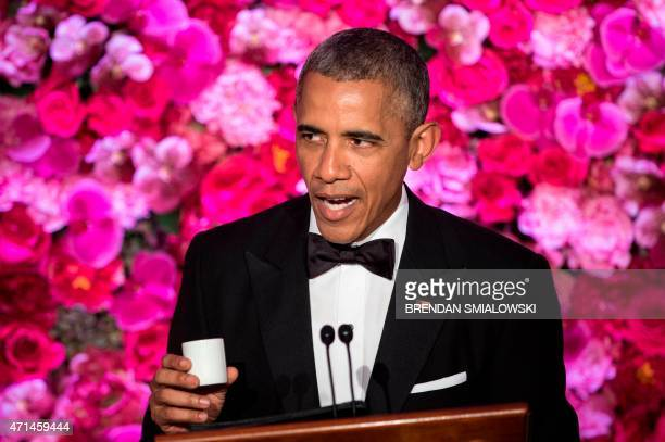 US President Barack Obama makes a toast with sake during a State Dinner for visiting Japanese Prime Minister Shinzo Abe at the White House on April...