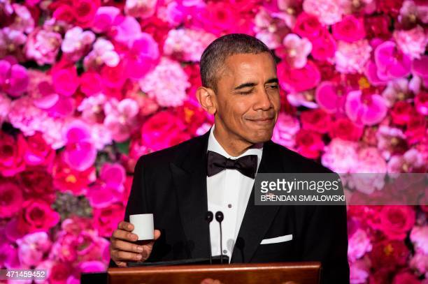 US President Barack Obama makes a toast with sake during a State Dinner for visiting Japanese Prime Minister Shinzo Abe at the White House April 28...