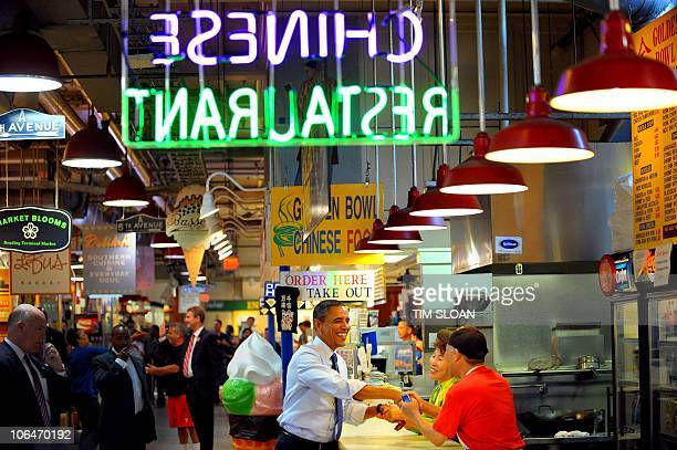 US President Barack Obama makes an unannounced visit to the Reading Terminal Market for a cheesesteak sandwich mint chocolate chip ice cream and...