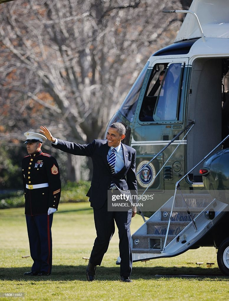 US President Barack Obama makes his way across the South Lawn to board Marine One on the South Lawn upon return to the White House on February 6, 2013 in Washington, DC. Obama returned from Annapolis, Maryland where he attended the Senate Democratic Issues Conference. AFP PHOTO/Mandel NGAN