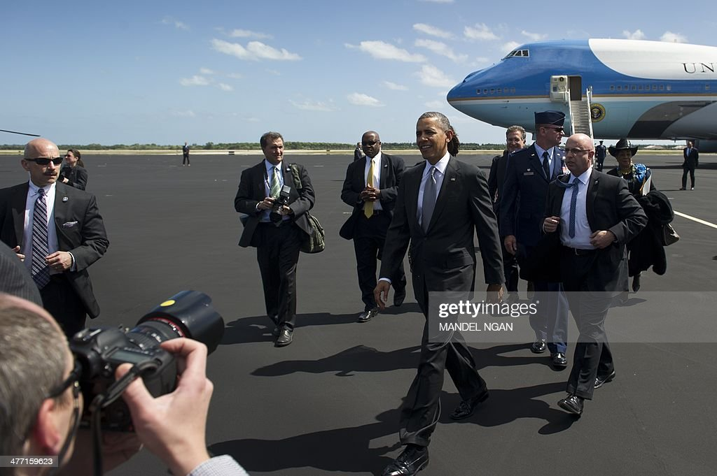 US President Barack Obama makes his way across the tarmac to greet well-wishers upon arrival at Homestead Air Reserve Base in Homestead, Florida on March 7, 2014. Obama is in Florida to speak at a high school and to spend the weekend with his wife. AFP PHOTO/Mandel NGAN