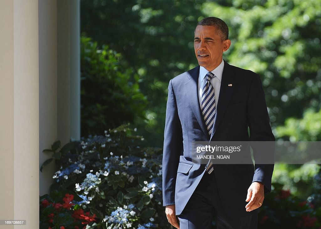 US President Barack Obama makes his way through the Colonnade to the Rose Garden to speak on student loans on May 31, 2013 at the White House in Washington, DC. AFP PHOTO/Mandel NGAN