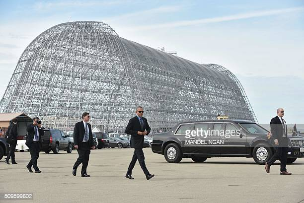 President Barack Obama makes his way to board Air Force One upon departure from Moffett Federal Airfield in Mountain View California on February 11...