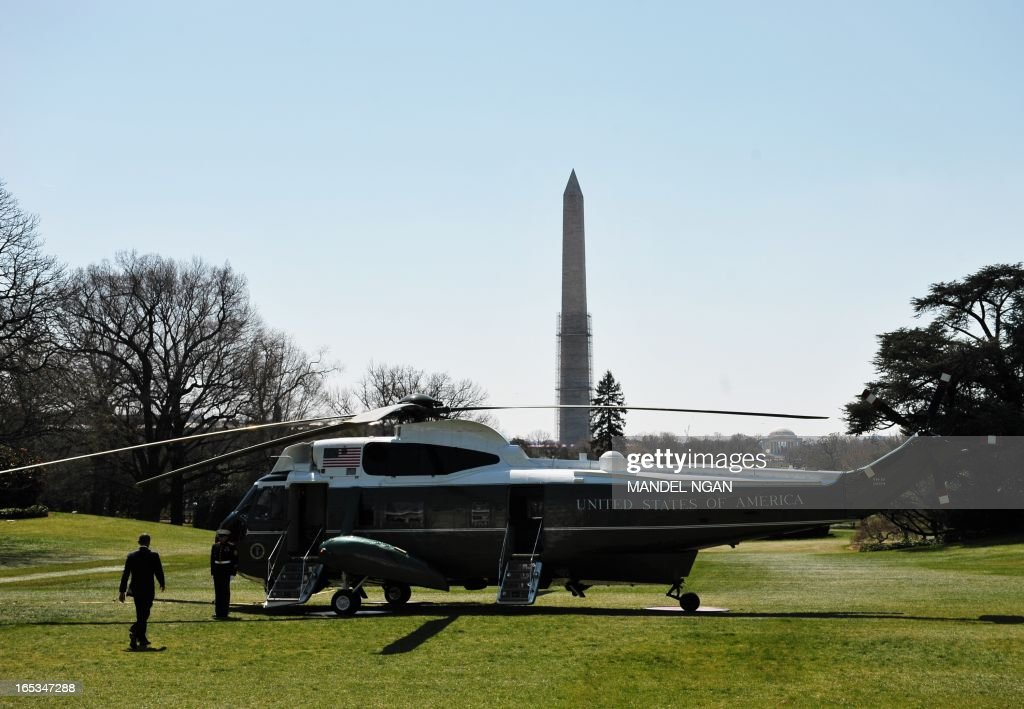 US President <a gi-track='captionPersonalityLinkClicked' href=/galleries/search?phrase=Barack+Obama&family=editorial&specificpeople=203260 ng-click='$event.stopPropagation()'>Barack Obama</a> makes his way to board Marine One April 3,2013 on the South Lawn of the White House in Washington, DC. Obama was headed for visits to Colorado and California. AFP PHOTO/Mandel NGAN