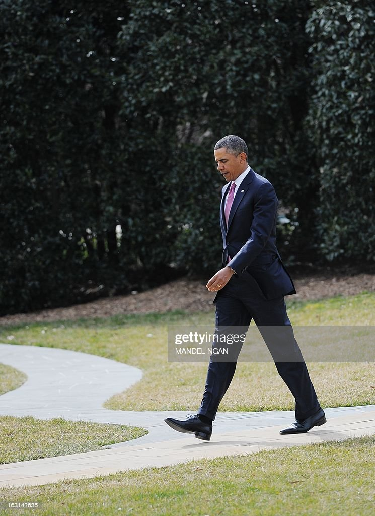 US President Barack Obama makes his way to board Marine One on March 5, 2013 from the South Lawn of the White House in Washington, DC. Obama was headed to Walter Reed National Military Medical Center in Bethesda, Maryland to visit wounded troops. AFP PHOTO/Mandel NGAN