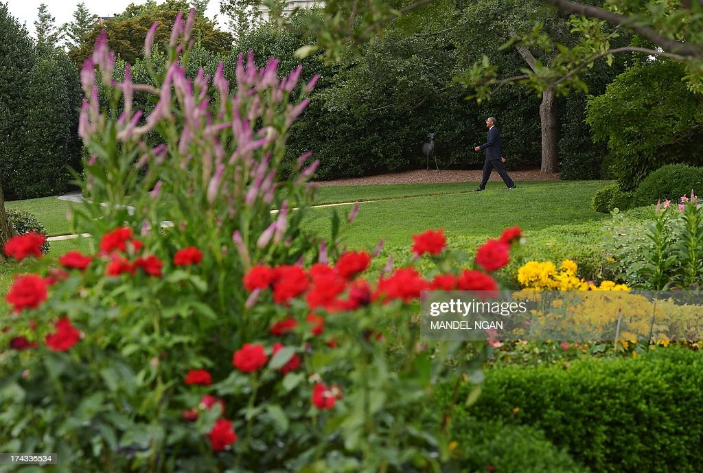 US President Barack Obama makes his way to board Marine One on the South Lawn of the White House on July 24, 2013 in Washington, DC. Obama is headed to Galesburg, Illinois and Warrensburg, Missouri to speak on the economy. AFP PHOTO/Mandel NGAN