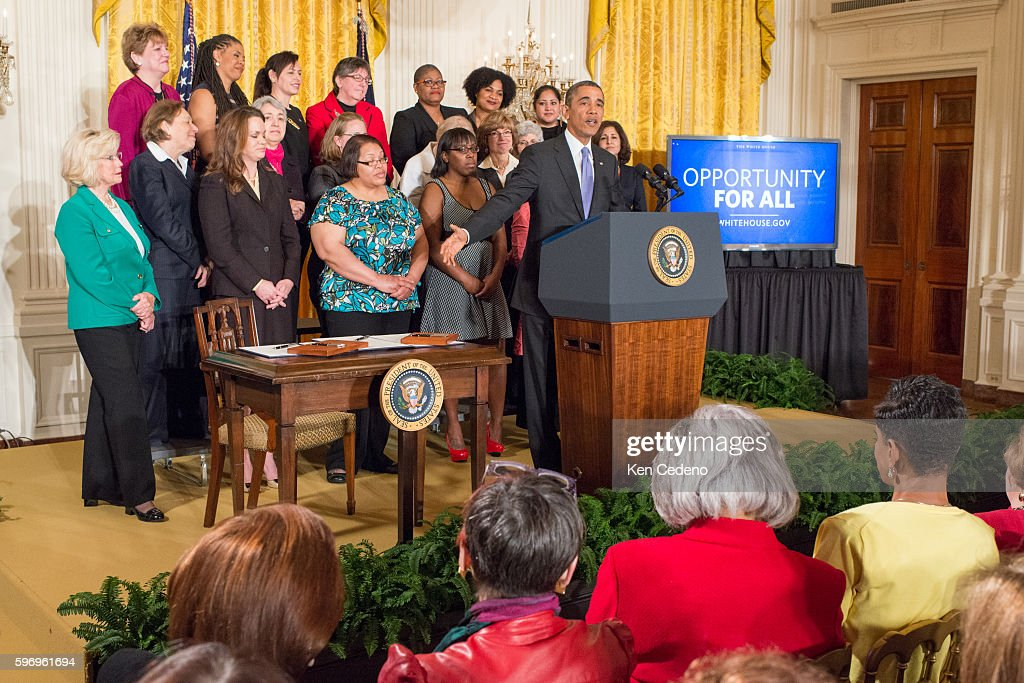 US President Barack Obama makes remarks in the East Room of the White House in Washington DC April 8 2014 Obama signs an Executive Order prohibiting...