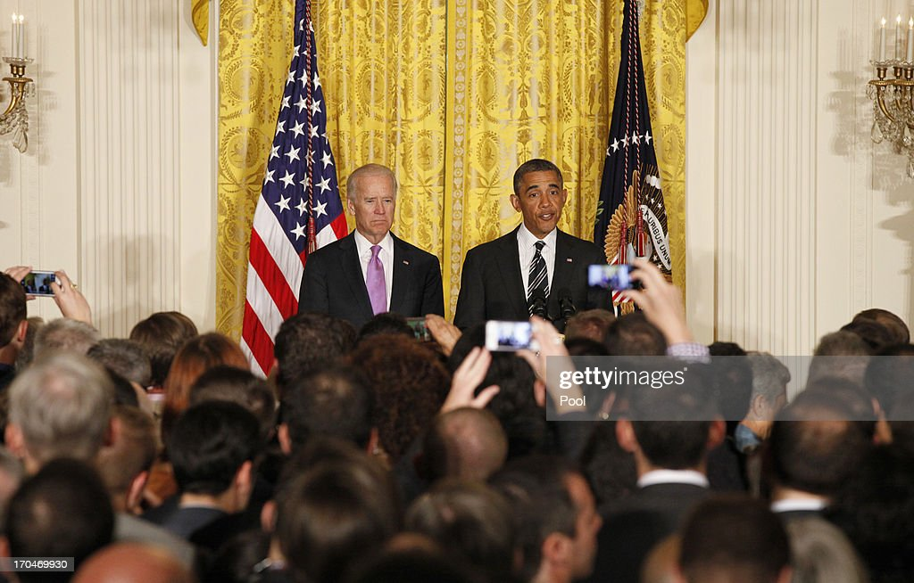 U.S. President <a gi-track='captionPersonalityLinkClicked' href=/galleries/search?phrase=Barack+Obama&family=editorial&specificpeople=203260 ng-click='$event.stopPropagation()'>Barack Obama</a> makes remarks next to Vice President Joe Biden at the LGBT Pride Month celebration on June 13, 2013 in the East Room at the White House in Washington DC.