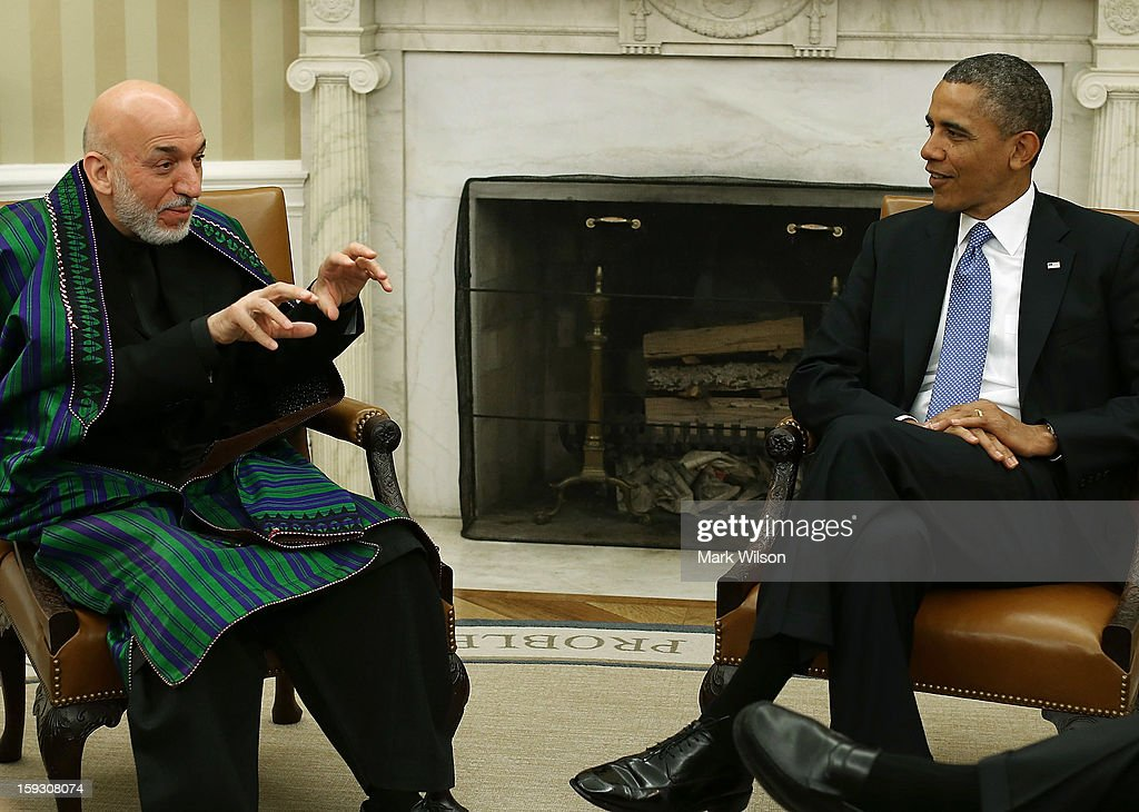 U.S. President <a gi-track='captionPersonalityLinkClicked' href=/galleries/search?phrase=Barack+Obama&family=editorial&specificpeople=203260 ng-click='$event.stopPropagation()'>Barack Obama</a> (R) meets with Afghan President <a gi-track='captionPersonalityLinkClicked' href=/galleries/search?phrase=Hamid+Karzai&family=editorial&specificpeople=121540 ng-click='$event.stopPropagation()'>Hamid Karzai</a> in the Oval Office at the White House, January 11, 2013 in Washington, DC. Karzai is on a visit in Washington to discuss the continued transition in Afghanistan and the partnership between the two nations.