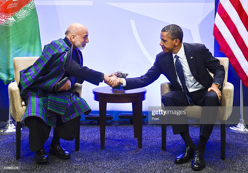 U.S. President <a gi-track='captionPersonalityLinkClicked' href=/galleries/search?phrase=Barack+Obama&family=editorial&specificpeople=203260 ng-click='$event.stopPropagation()'>Barack Obama</a> (R) meets with Afghanistan President Hamid Karzai at the NATO summit at McCormick Place on May 20, 2012 in Chicago, Illinois. As sixty heads of state converge for the two day summit that will address the situation in Afghanistan among other global defense issues, thousands of demonstrators have taken the streets to protest.