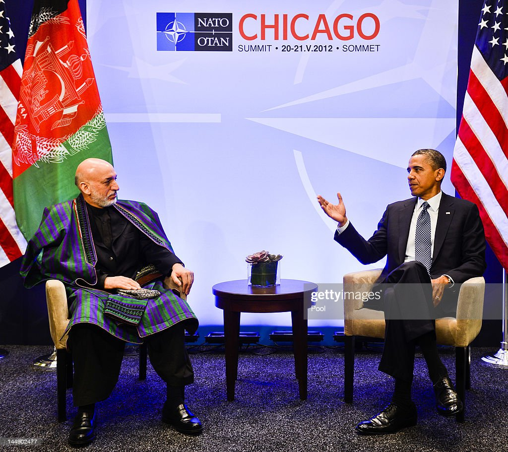 U.S. President <a gi-track='captionPersonalityLinkClicked' href=/galleries/search?phrase=Barack+Obama&family=editorial&specificpeople=203260 ng-click='$event.stopPropagation()'>Barack Obama</a> (R) meets with Afghanistan President <a gi-track='captionPersonalityLinkClicked' href=/galleries/search?phrase=Hamid+Karzai&family=editorial&specificpeople=121540 ng-click='$event.stopPropagation()'>Hamid Karzai</a> at the NATO summit at McCormick Place on May 20, 2012 in Chicago, Illinois. As sixty heads of state converge for the two day summit that will address the situation in Afghanistan among other global defense issues, thousands of demonstrators have taken the streets to protest.