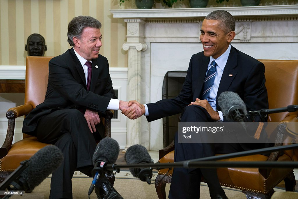 U.S. President <a gi-track='captionPersonalityLinkClicked' href=/galleries/search?phrase=Barack+Obama&family=editorial&specificpeople=203260 ng-click='$event.stopPropagation()'>Barack Obama</a> meets with Colombian President <a gi-track='captionPersonalityLinkClicked' href=/galleries/search?phrase=Juan+Manuel+Santos&family=editorial&specificpeople=974752 ng-click='$event.stopPropagation()'>Juan Manuel Santos</a> in the Oval Office of the White House on February 4, 2016 in Washington, DC. Obama and Santos are expected to make a bid for increased aid for Colombia and talk about 'Plan Colombia', a U.S. aid initiative started in 2000 to help combat Colombian drug cartels.