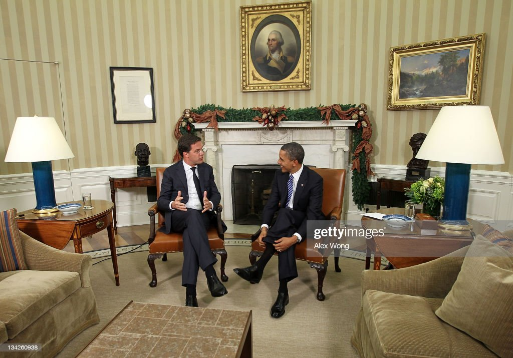 S President Barack Obama meets with Dutch Prime Minister Mark Rutte at the Oval Office of the White House November 29 2011 in Washington DC The two...