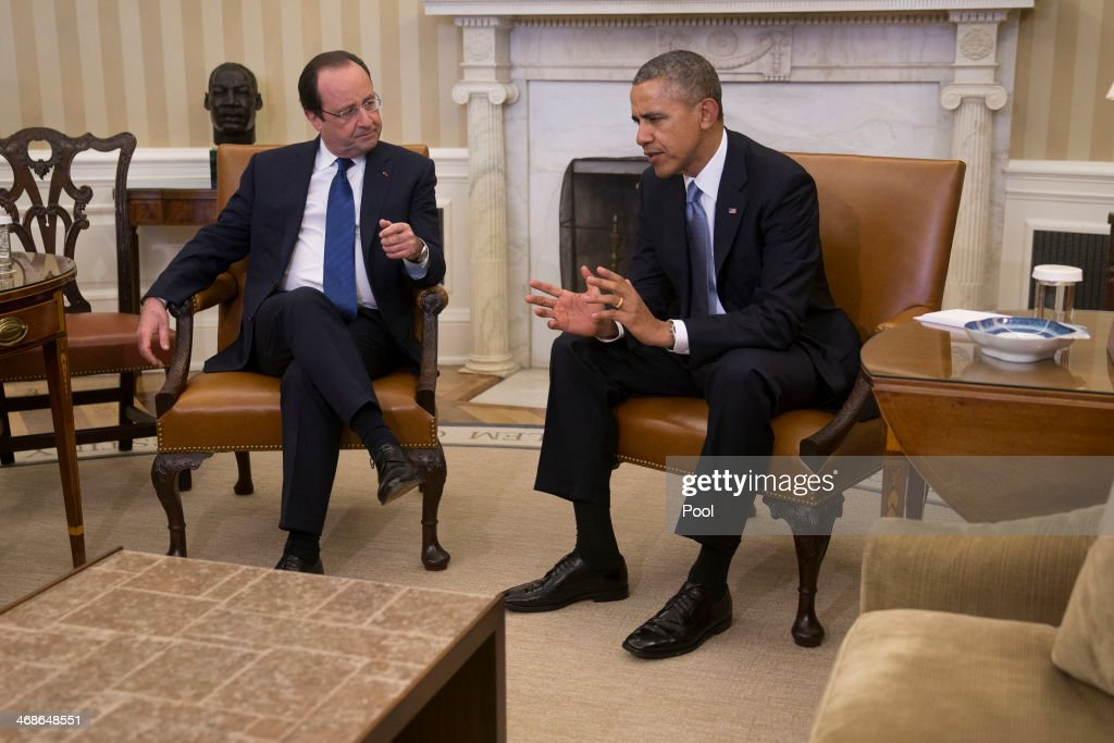 U.S. President <a gi-track='captionPersonalityLinkClicked' href=/galleries/search?phrase=Barack+Obama&family=editorial&specificpeople=203260 ng-click='$event.stopPropagation()'>Barack Obama</a> (R) meets with French President Francois Hollande in the Oval Office at the White House on February 11, 2014 in Washington, DC. Hollande who arrived yesterday for a three day state trip, visited Thomas Jefferson's Monticello estate and will be the guest of honor for a state dinner tonight.