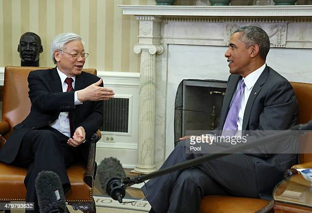 S President Barack Obama meets with General Secretary Nguyen Phu Trong of Vietnam in the Oval Office of the White House July 7 2015 in Washington DC...