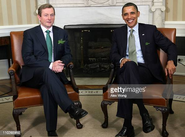 S President Barack Obama meets with Irish Prime Minister Enda Kenny in the Oval Office of the White House March 17 2011 in Washington DC President...