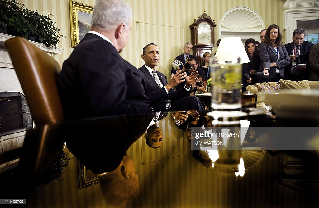 US President <a gi-track='captionPersonalityLinkClicked' href=/galleries/search?phrase=Barack+Obama&family=editorial&specificpeople=203260 ng-click='$event.stopPropagation()'>Barack Obama</a> (C) meets with Israeli Prime Minister Benjamin Netanyahu in the Oval Office of the White House in Washington, DC, May 20, 2011. Obama announced on Thursday in his long-awaited speech on the 'Arab Spring' revolts that territorial lines in place before the 1967 Arab-Israeli war should be the basis for a peace deal, a move Netanyahu has long opposed. AFP PHOTO / Jim WATSON