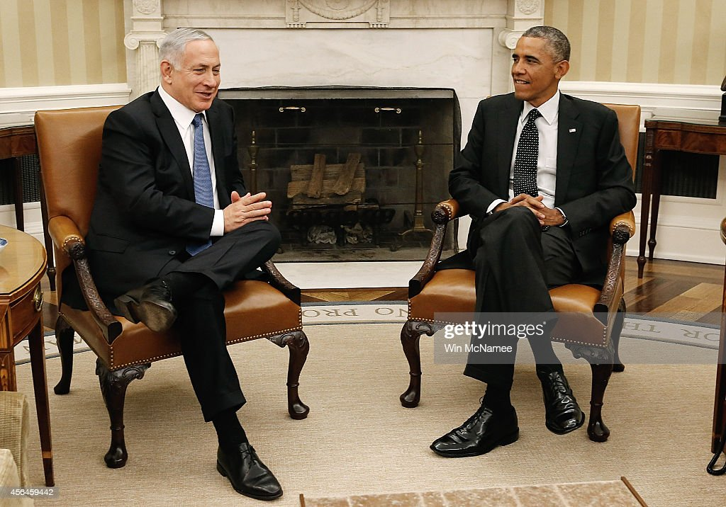 S President Barack Obama meets with Israeli Prime Minister Benjamin Netanyahu in the Oval Office of the White House October 1 2014 in Washington DC...