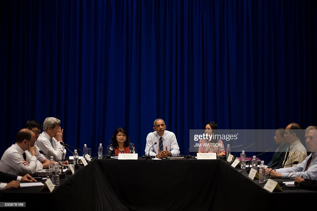 US President Barack Obama meets with members of the civil society in Hanoi on May 24, 2016. Obama, currently on a visit to Vietnam, met with civil society leaders including some of the country's long-harassed critics on May 24. The visit is Obama's first to the country -- and the third by a sitting president since the end of the Vietnam War in 1975. / AFP / JIM