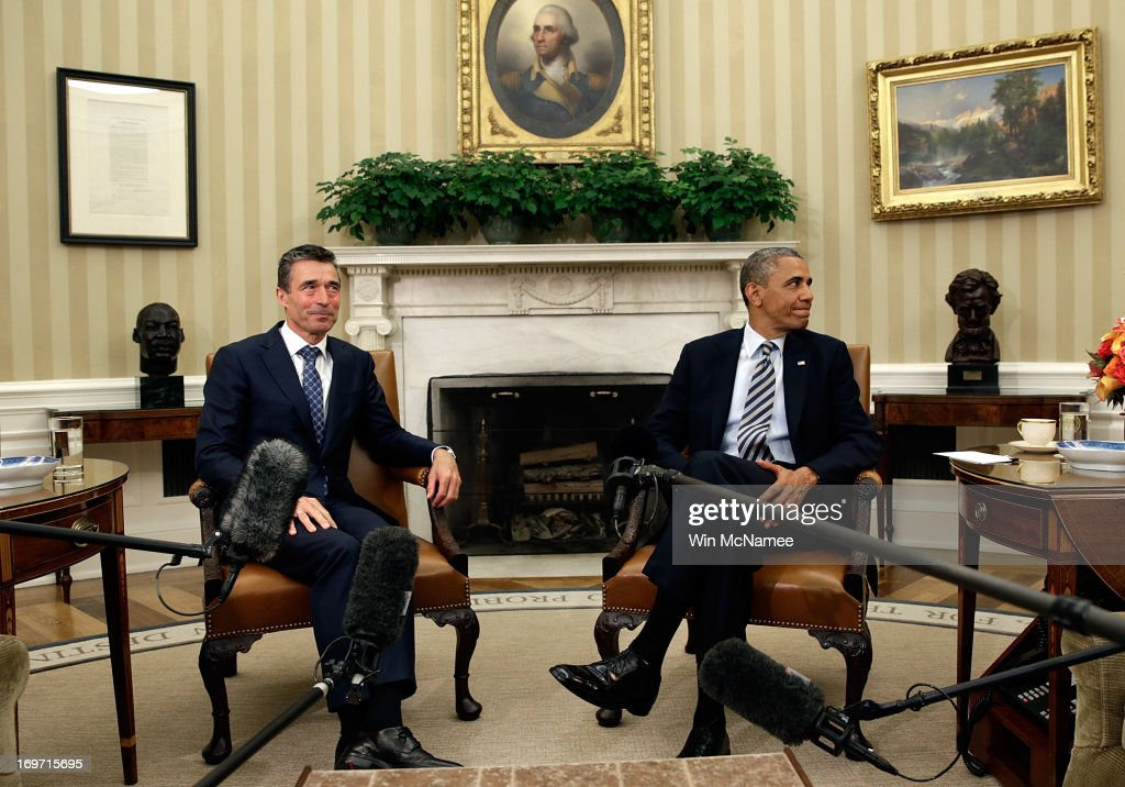 U.S. President <a gi-track='captionPersonalityLinkClicked' href=/galleries/search?phrase=Barack+Obama&family=editorial&specificpeople=203260 ng-click='$event.stopPropagation()'>Barack Obama</a> (R) meets with NATO Secretary General <a gi-track='captionPersonalityLinkClicked' href=/galleries/search?phrase=Anders+Fogh+Rasmussen&family=editorial&specificpeople=549374 ng-click='$event.stopPropagation()'>Anders Fogh Rasmussen</a> in the Oval Office of the White House May 31, 2013 in Washington, DC. The two leaders were expected to discuss the continued reduction of troop levels in Afghanistan and other issues.