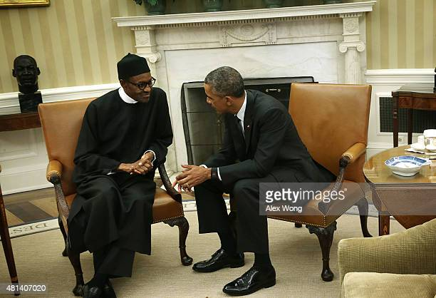 US President Barack Obama meets with Nigerian President Muhammadu Buhari in the Oval Office of the White House July 20 2015 in Washington DC The two...