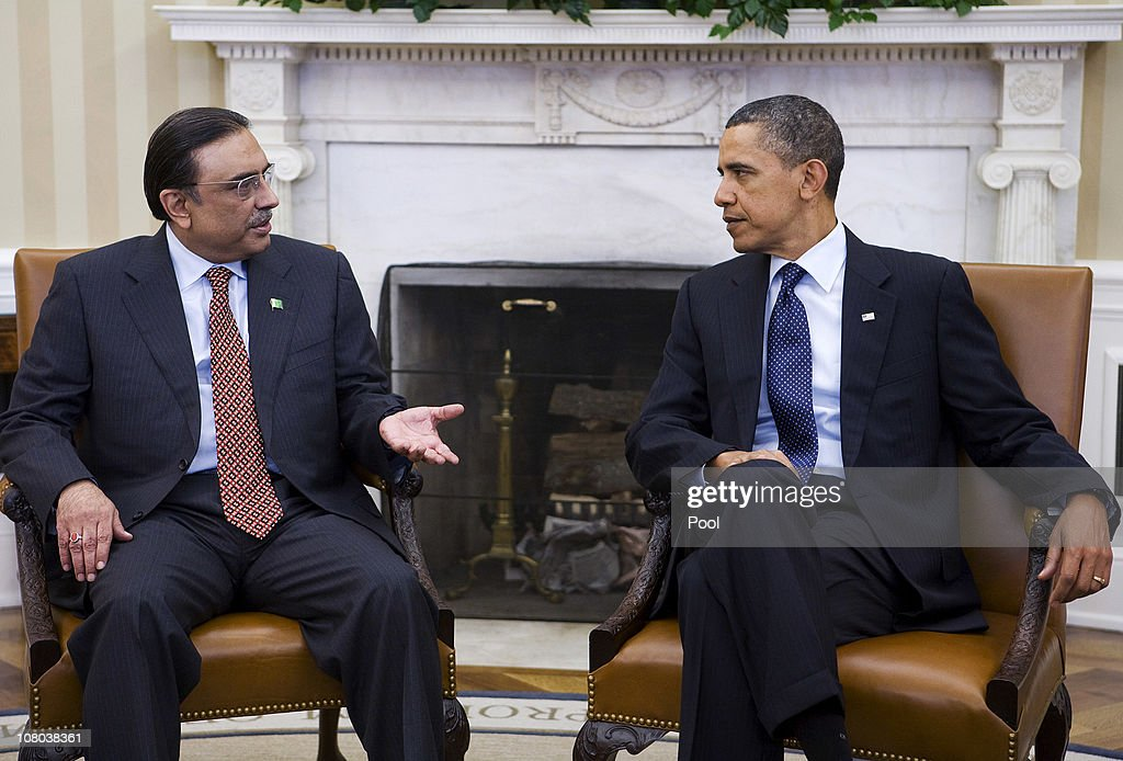 U.S. President <a gi-track='captionPersonalityLinkClicked' href=/galleries/search?phrase=Barack+Obama&family=editorial&specificpeople=203260 ng-click='$event.stopPropagation()'>Barack Obama</a> (R) meets with Pakistan's President <a gi-track='captionPersonalityLinkClicked' href=/galleries/search?phrase=Asif+Ali+Zardari&family=editorial&specificpeople=1125723 ng-click='$event.stopPropagation()'>Asif Ali Zardari</a> in the Oval Office of the White House December 14, 2011 in Washington, DC. <a gi-track='captionPersonalityLinkClicked' href=/galleries/search?phrase=Asif+Ali+Zardari&family=editorial&specificpeople=1125723 ng-click='$event.stopPropagation()'>Asif Ali Zardari</a> is in Washington to attend the memorial fro Richard Holbrook and is meeting Obama for closed press meeting.