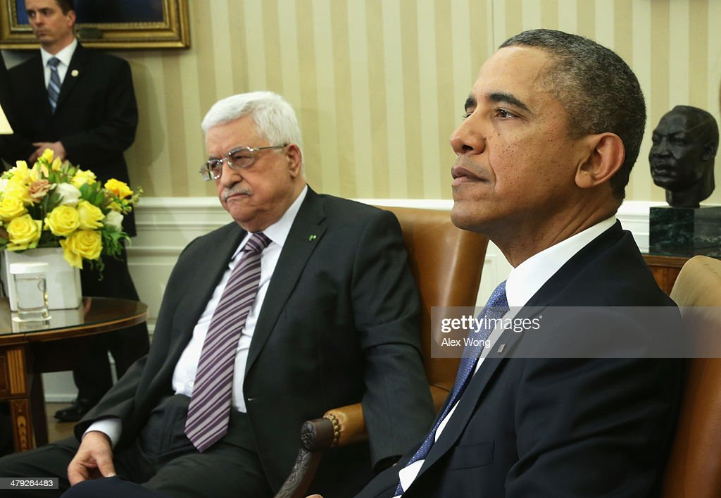 U.S. President <a gi-track='captionPersonalityLinkClicked' href=/galleries/search?phrase=Barack+Obama&family=editorial&specificpeople=203260 ng-click='$event.stopPropagation()'>Barack Obama</a> (R) meets with Palestinian President <a gi-track='captionPersonalityLinkClicked' href=/galleries/search?phrase=Mahmoud+Abbas&family=editorial&specificpeople=176534 ng-click='$event.stopPropagation()'>Mahmoud Abbas</a> (L) in the Oval Office of the White House March 17, 2014 in Washington, DC. President Obama met with President Abbas to discuss the progress in the Israeli-Palestinian negotiations and the establishment of a Palestinian state.
