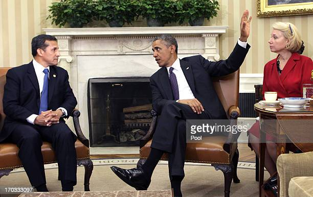 US President Barack Obama meets with Peru President Ollanta Humala in the Oval Office of the White House on June 11 2013 in Washington DC This is...
