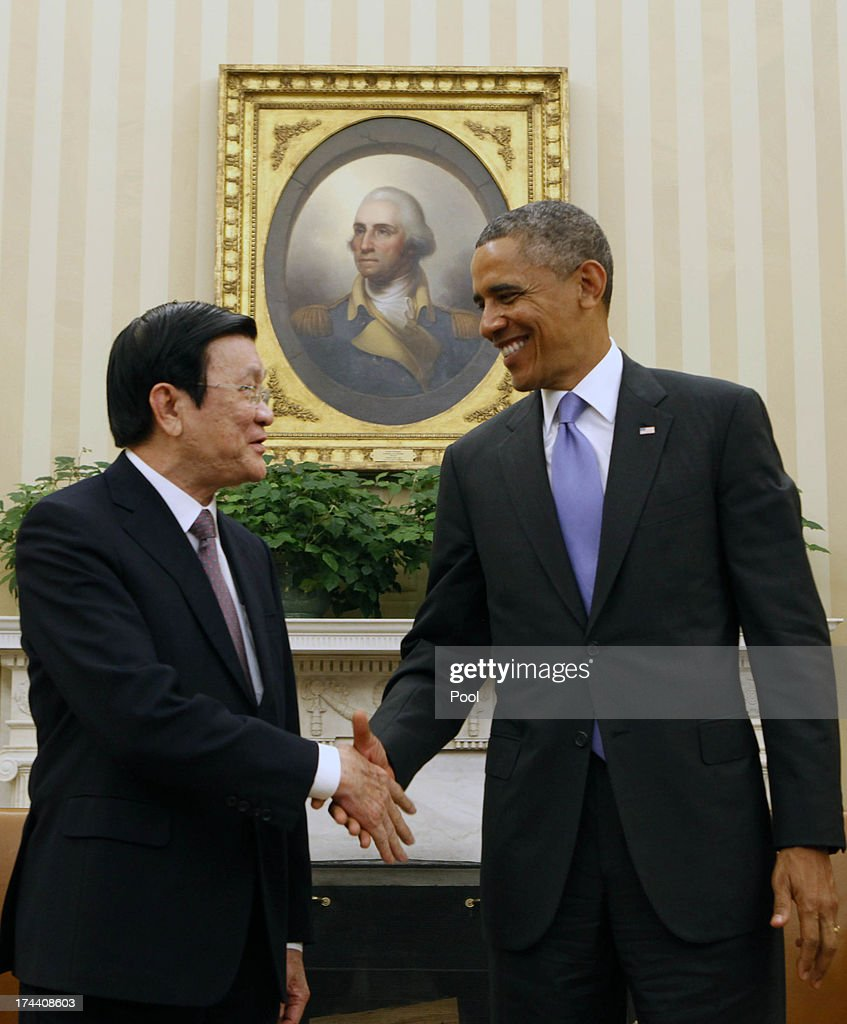 President <a gi-track='captionPersonalityLinkClicked' href=/galleries/search?phrase=Barack+Obama&family=editorial&specificpeople=203260 ng-click='$event.stopPropagation()'>Barack Obama</a> meets with President Truong Tan Sang of Vietnam in the Oval Office on July 25, 2013 in Washington, D.C. The visit is seen as an important step in improving U.S.-Vietnam relations. Mr. Sang is the second Vietnamese president to visit the White House since 1995.