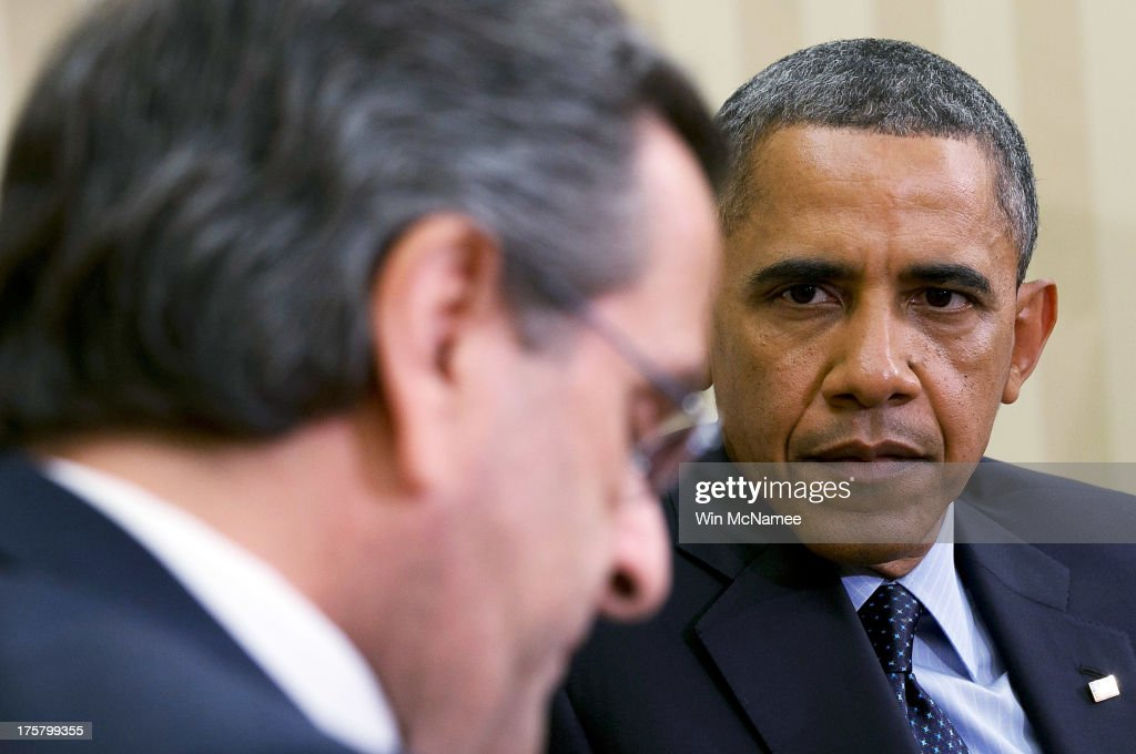 U.S. President <a gi-track='captionPersonalityLinkClicked' href=/galleries/search?phrase=Barack+Obama&family=editorial&specificpeople=203260 ng-click='$event.stopPropagation()'>Barack Obama</a> (R) meets with Prime Minister <a gi-track='captionPersonalityLinkClicked' href=/galleries/search?phrase=Antonis+Samaras&family=editorial&specificpeople=970799 ng-click='$event.stopPropagation()'>Antonis Samaras</a> (L) of Greece in the Oval Office of the White House August 8, 2013 in Washington, DC. Obama and Samras discussed a range of bilateral issues during their meeting.
