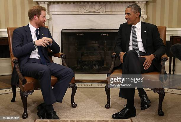 S President Barack Obama meets with Prince Harry in the Oval Office of the White House October 28 2015 in Washington DC Prince Harry is on a one day...