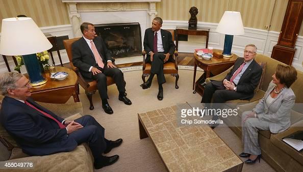 S President Barack Obama meets with Senate Minority Leader Mitch McConnell Speaker of the House John Boehner Senate Majority Leader Harry Reid and...