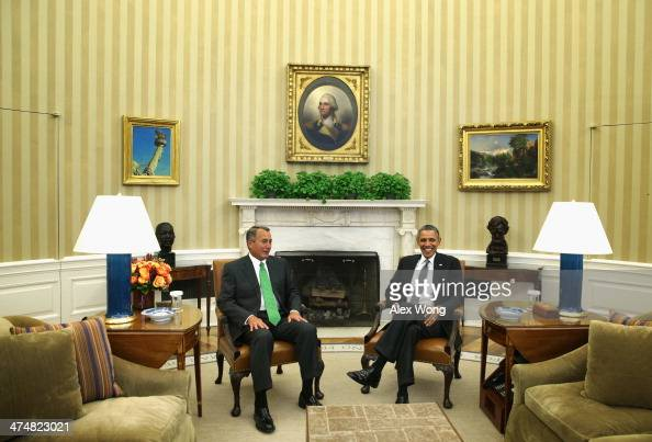 US President Barack Obama meets with Speaker of the House Rep John Boehner at the Oval Office of the White House February 25 2014 in Washington DC...