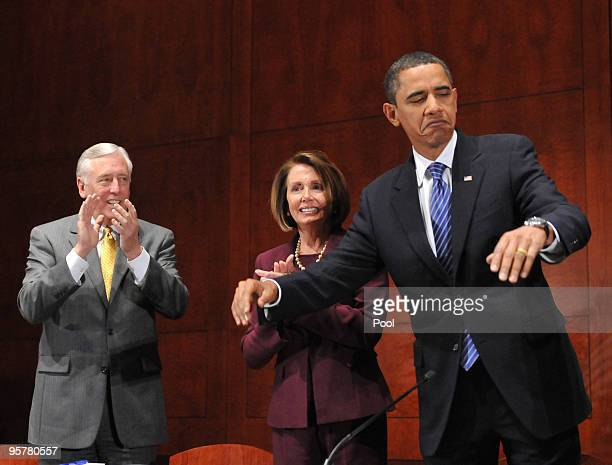 President Barack Obama motions for everybody to sit down before delivering remarks to the House Democratic Caucus retreat at the US Capitol Visitors...